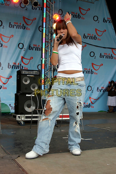 LIBERTY X - JESSICA TAYLOR.Performs live at BRMB's Party In The Park, .Cannon Hill Park, Birmingham, .3rd July 2005..full length concert gig close up jeans ripped holes calvin klein underwear gold belt knickers boxers rubber bracelets.Ref: JEZ.www.capitalpictures.com.sales@capitalpictures.com.©Jez Self/Capital Pictures
