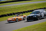 Keith Pickering/Graham Meeks - FB Motorsport Ginetta G20 & Mark Flower/Stewart Smith - BUC Racing BMW E46 M3