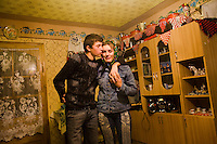 ROMANIA / Maramures / Mara / 18.10.2006 ..Ion, 16, from the village of Budesti visits Marioara, 16, at her home. It is a tradition for young men to visit casually with different women while searching for a girlfriend or future wife. ..© Davin Ellicson / Anzenberger