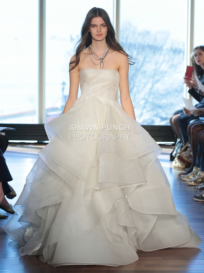 """Model Tess walks runway in a """"Bowie"""" bridal gown from the Rivini Spring Summer 2017 bridal collection by Rita Vinieris at The Standard Highline Room, during New York Bridal Fashion Week on April 15, 2016."""