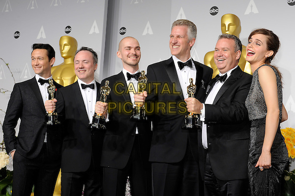 HOLLYWOOD, CA - MARCH 2: Joseph Gordon-Levitt, Timothy Webber, Neil Corbould, Chris Lawrence, David Shirk, Emma Watson  in the press room at the 2014 Oscars at the Hollywood and Highland Center in Hollywood, California. March 2, 2014. <br /> CAP/MPI/COR99<br /> &copy;COR99/MediaPunch/Capital Pictures