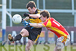Shane Doolan., Dr. Crokes in action against Tom King, in the All Ireland Senior Club Semi Final at Portlaoise on Saturday.