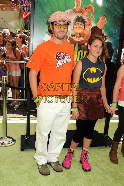 "Rob Morrow & guests.""ParaNorman"" Los Angeles Premiere held at AMC CityWalk Stadium 19 Theatre, Universal City, California, USA..August 5th, 2012.full length white trousers batman print t-shirt black skirt brown velvet leggings orange tinted yellow glasses stubble facial hair .CAP/ADM/BP.©Byron Purvis/AdMedia/Capital Pictures."