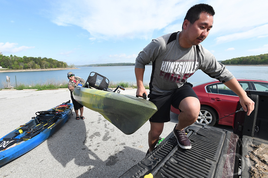 NWA Democrat-Gazette/J.T. WAMPLER Billy Yang (right) and his brother Steve Yang, both of Rogers, load their pedal-powered boats Wednesday April 19, 2017 at Beaver Lake. The brothers spent the morning cruising the lake and fishing but didn't catch anything.