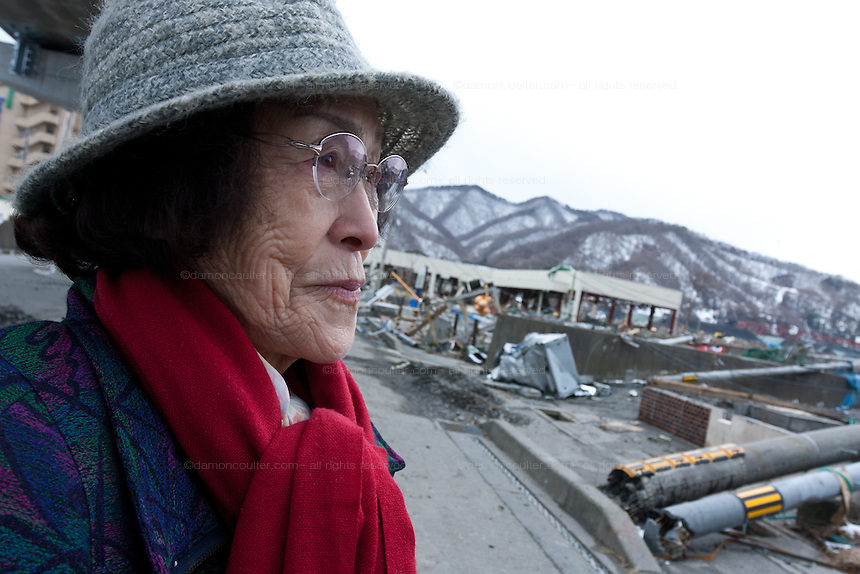 Itako Kanagawa 80 years of age and a survivor of the Hiroshima bombing  looks at tsunami damage in Kamaishi, Iwate, Japan. March 17th 2011