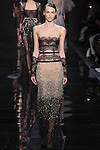 """Model walks runway in an ombre nude/black lace embroidered dress from the Reem Acra Fall 2016 """"The Secret World of The Femme Fatale"""" collection, at NYFW: The Shows Fall 2016, during New York Fashion Week Fall 2016."""
