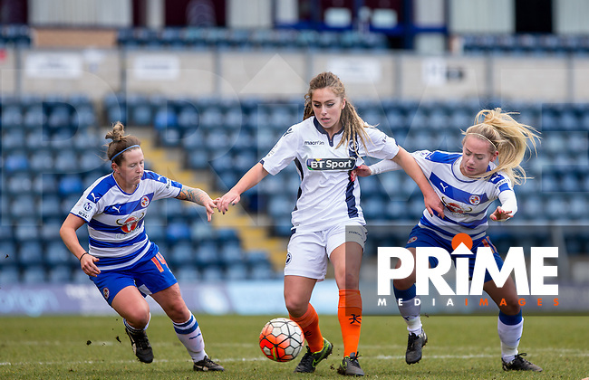 Amber Gaylor of Millwall Lionesses holds off Laura Walkley of Reading Women & Charlie Estcourt  (right) of Reading Women during the Women's FA Cup match between Reading Women and Millwall Lionesses at Adams Park, High Wycombe, England on 20 March 2016. Photo by Andy Rowland.