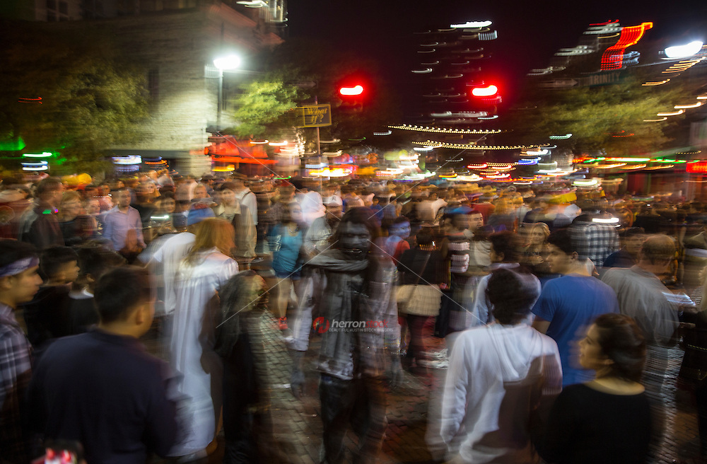 On Halloween, Ghost, Ghouls, and Zombies roam the streets on Sixth (6th) Street in downtown Austin, Texas