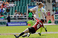 Emily Scarratt of England breaks through the tackle of Landry during the iRB Challenge Cup at Twickenham on Sunday 13th May 2012 (Photo by Rob Munro)