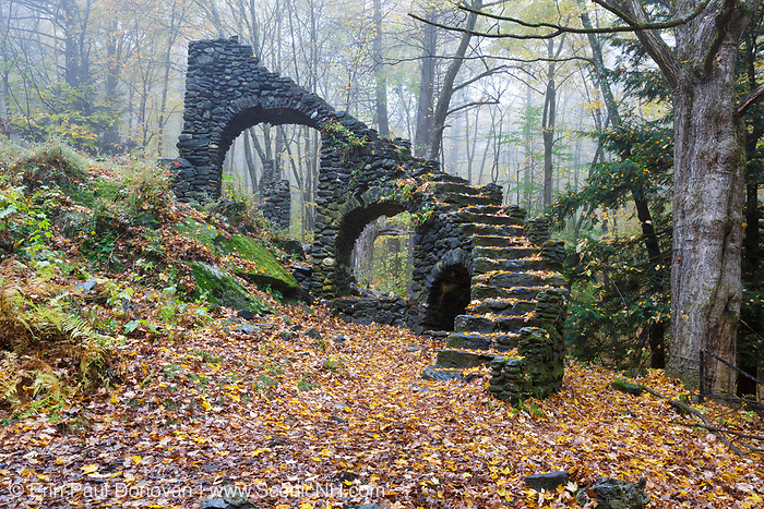 The ruins of Madame Antoinette Sherri's castle in Madame Sherri Forest in Chesterfield, New Hampshire during the autumn months. Madame Antoinette Sherri was a 1920s costume designer from New York, who was known for throwing parties for visitors from the city. The castle was destroyed by fire on October 18, 1962. The foundation and a stone staircase are all that remains.
