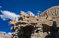 746000011 strange sandstone formations stand watch over the landscape in fantasy canyon a blm property in the middle of a working oil field in northeastern utah united states