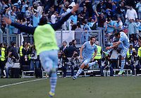 Calcio, finale di Coppa Italia: Roma vs Lazio. Roma, stadio Olimpico, 26 maggio 2013..Lazio midfielder Senad Lulic, of Bosnia, center, celebrates with teammate Stefan Radu, right, after scoring during the Italian Cup football final match between AS Roma and Lazio at Rome's Olympic stadium, 26 May 2013..UPDATE IMAGES PRESS/Isabella Bonotto....