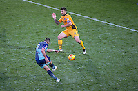 Paul Hayes of Wycombe Wanderers hits a shot past Darren Jones of Newport County during the Sky Bet League 2 match between Wycombe Wanderers and Newport County at Adams Park, High Wycombe, England on 2 January 2017. Photo by Andy Rowland.