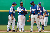 30 july 2010: Felix Brown of Team France is seen next to Maxime Lefevre (left), Omar Williams, and Florian Peyrichou during Italy 9-2 win over France, in day 6 of the 2010 European Championship Seniors, at TV Cannstatt ballpark, in Stuttgart, Germany.
