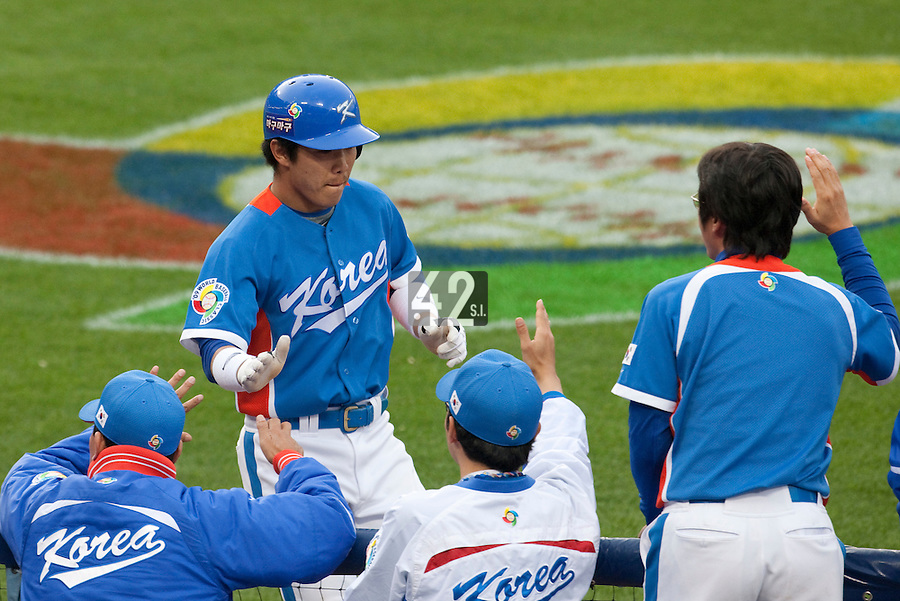 21 March 2009: #8 Keun-Woo Jeong of Korea celebrates with teammates after scoring on a groundout by #10 Dae Ho Lee in the first inning during the 2009 World Baseball Classic semifinal game at Dodger Stadium in Los Angeles, California, USA. Korea wins 10-2 over Venezuela.
