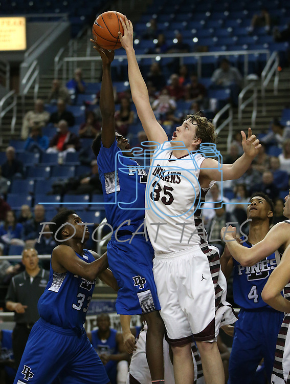 Elko's Brian Pearson blocks a shot from Desert Pines' Keith Re'Meake during the NIAA basketball state tournament at Lawlor Events Center, in Reno, Nev., on Friday, Feb. 28, 2014. Elko won 63-47 to advance to the state championship game. (Cathleen Allison/Las Vegas Review-Journal)