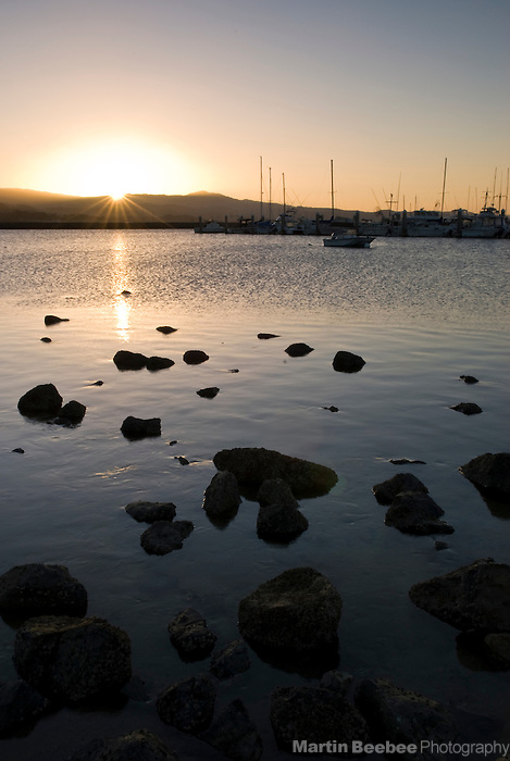 Sunrise over fishing boats in Pillar Point Harbor, Half Moon Bay, California