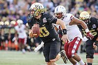 Annapolis, MD - December 27, 2016: Wake Forest Demon Deacons quarterback John Wolford (10) runs the ball during game between Temple and Wake Forest at  Navy-Marine Corps Memorial Stadium in Annapolis, MD.   (Photo by Elliott Brown/Media Images International)