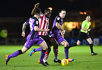 Lincoln City's John Akinde gets between Port Vale's Mitchell Clark, left, and Antony Kay<br /> <br /> Photographer Andrew Vaughan/CameraSport<br /> <br /> The EFL Sky Bet League Two - Lincoln City v Port Vale - Tuesday 1st January 2019 - Sincil Bank - Lincoln<br /> <br /> World Copyright &copy; 2019 CameraSport. All rights reserved. 43 Linden Ave. Countesthorpe. Leicester. England. LE8 5PG - Tel: +44 (0) 116 277 4147 - admin@camerasport.com - www.camerasport.com