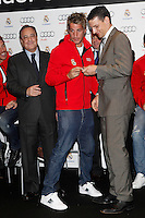 Real Madrid player Fabio Coentrao (c) and the President Florentino Perez participate and receive new Audi during the presentation of Real Madrid's new cars made by Audi at the Jarama racetrack on November 8, 2012 in Madrid, Spain.(ALTERPHOTOS/Harry S. Stamper) .<br />