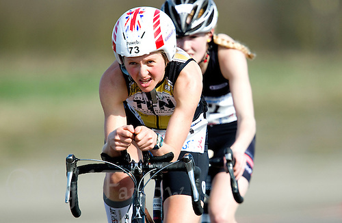 25 MAR 2012 - LOUGHBOROUGH, GBR - Lucy Gossage (TFN) leads Racheal Bamford (Dirtwheels Cycles / LBT) on the bike during the women's 2012 British Elite Duathlon Championship race at Prestwold Hall Airfield in Prestwold near Loughborough, Great Britain .(PHOTO (C) 2012 NIGEL FARROW)
