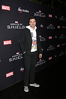 "LOS ANGELES - FEB 24:  Brett Dalton at ""Marvel's Agents Of S.H.I.E.L.D."" 100th Episode Party at Ohm Nightclub on February 24, 2018 in Los Angeles, CA"