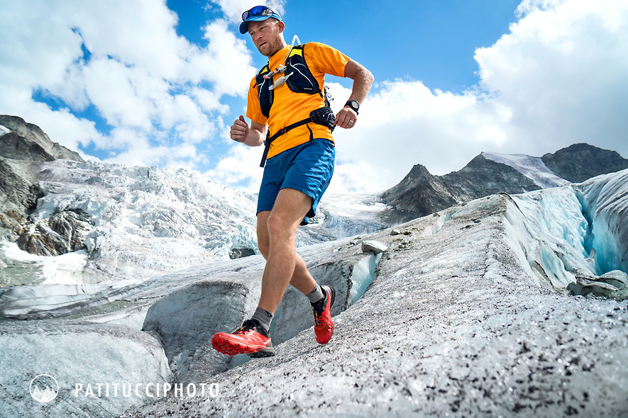 Running across the Glacier de Moiry next to a large crevasse while on a trail running tour in the Wallis region of Switzerland.