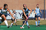 25 October 2014: North Carolina's Casey Di Nardo (21) is challenged by Wake Forest's Anna Kozniuk (CAN) (left). The University of North Carolina Tar Heels hosted the Wake Forest University Demon Deacons at Francis E. Henry Stadium in Chapel Hill, North Carolina in a 2014 NCAA Division I Field Hockey match. UNC won the game 3-1.