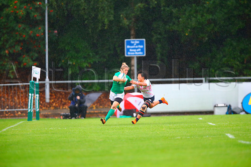 23.08.2015. Dublin, Ireland. Women's Sevens Series Qualifier 2015. Japan versus Ireland<br /> Alison Miller (Ireland) hands off a tackle from Yume Okuroda (Japan)