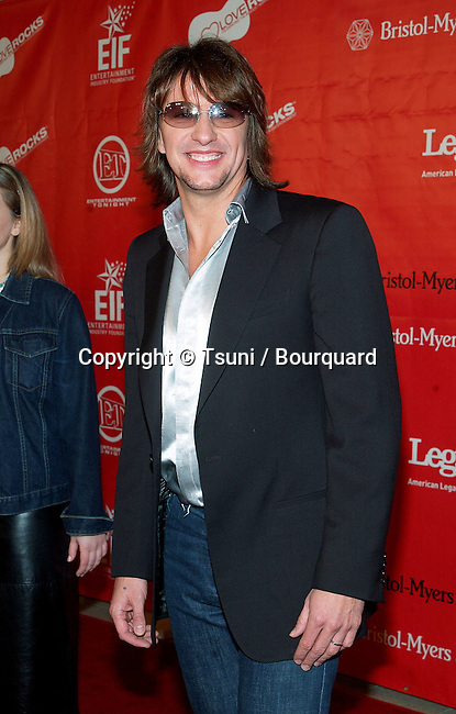 """Richie Sambora arriving at the First Annual Entertainment Industry Foundation """" Love Rocks """". Concert  to Celebrate the biggest Heart in Entertainment. February 14, 2002.            -            SamboraRichie08.jpg"""
