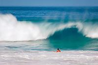 breaking wave and bodyboarders during large surf at Magic sands beach, Kailua Kona The Big Island of Hawaii