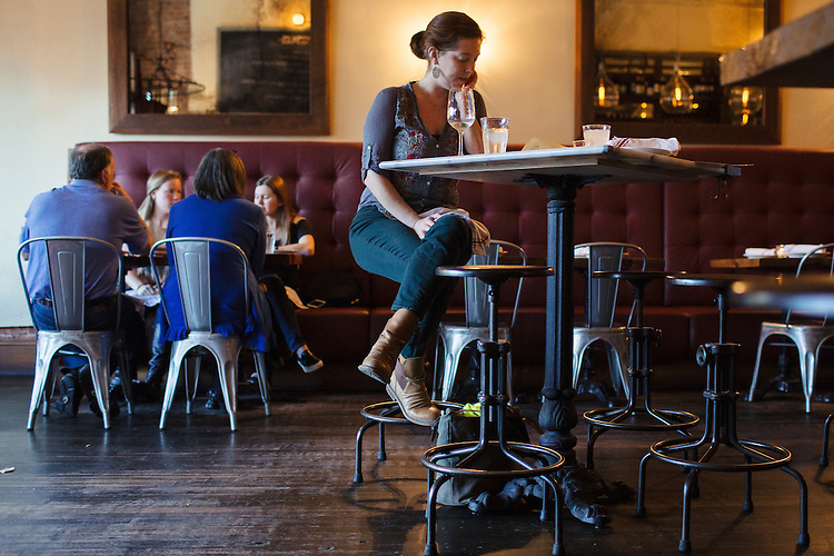 Durham, North Carolina - Friday October 30, 2015 - Sarah Brittingham, of Durham, NC, waits for a friend at Mateo, in Durham.