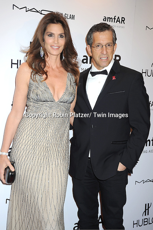Cindy Crawford and Kenneth Cole arrives at the amfAR New York Gala to kick off Fashion Week on February 8, 2012 at Cipriani Wall Street in New York City.