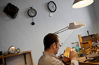 Florian Wulleman, watchmaker, at work in his Atelier d'Horlogerie, Place du Frene, Vence, France, 17 November 2010