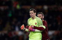 Calcio, Serie A: Roma vs Milan. Roma, stadio Olimpico, 12 dicembre 2016.<br /> Roma&rsquo;s goalkeeper Wojciech Szczesny, left, is hugged by teammate Daniele De Rossi after saving a penalty kicked by Milan's M'Baye Niang, not seen, during the Italian Serie A football match between Roma and AC Milan at Rome's Olympic stadium, 12 December 2016.<br /> UPDATE IMAGES PRESS/Isabella Bonotto
