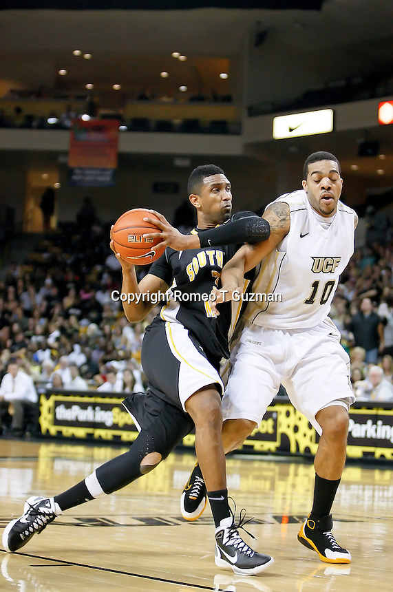February 26, 2011: Southern Miss forward Josimar Ayarza (3) drives the paint on Central Florida forward Dwight McCombs (10) during first half mens Conference USA NCAA basketball game action between the Southern Miss Golden Eagles and the Central Florida Knights at the UCF Arena in Orlando, Fl..