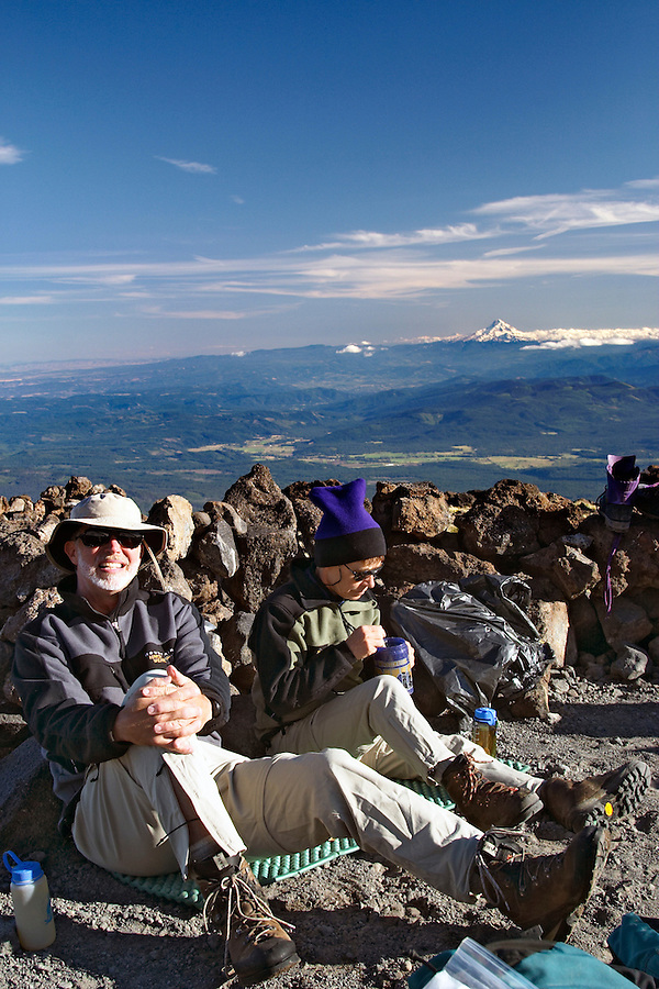 Man and woman sitting in an alpine camp, Mount Adams, Yakima County, Cascade  Mountains, Washington, USA