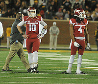 NWA Media/Michael Woods --11/28/2014-- w @NWAMICHAELW...University of Arkansas quarterback Bandon Allen and Keon Hatcher wait on the sidelines as the officials review the ruling of an Arkansas fumble late in the 4th quarter of Friday afternoons game against Missouri at Faurot Field in Columbia Missouri.