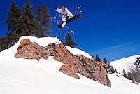 Snowboarder jumping.