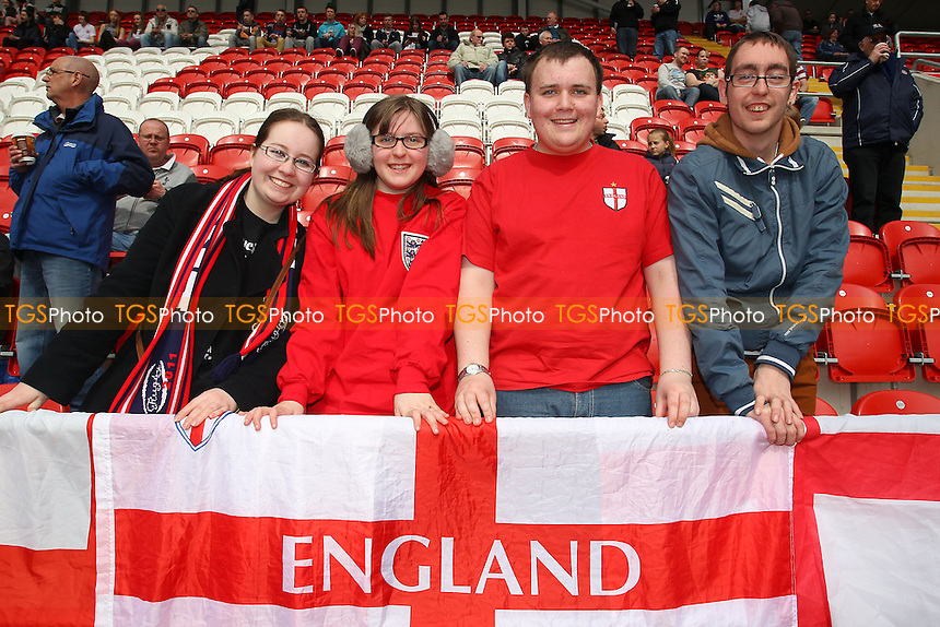 England fans are seen ahead of kick-off - England Women vs Canada Women - International Football Friendly Match at the New York Stadium, Rotherham United FC - 07/04/13 - MANDATORY CREDIT: Gavin Ellis/TGSPHOTO - Self billing applies where appropriate - 0845 094 6026 - contact@tgsphoto.co.uk - NO UNPAID USE.