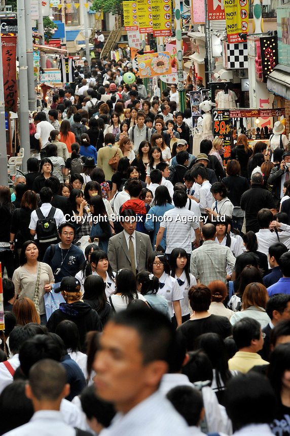 Shoppers in the Harajuku district of downtown Tokyo, Japan. .