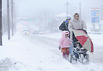 The Gazette Hyattsville residents (from front to back)Glenda Molina, Ivania Villalobos, 4 and her mother Natlomi Villalobos take a walk on Route 1 in Hyattsville on Saturday afternoon during the blizzard.