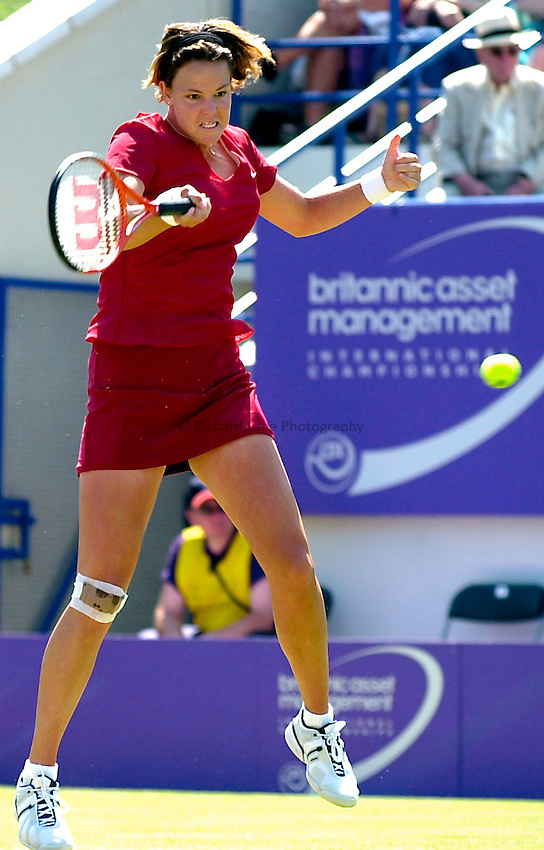 Photo. Rene Solari..21/6/01  .Eastbourne Day 4.  Lindsay Davenport shows agression and power as she hits this forehand against Italian Silvia Farina Elia...