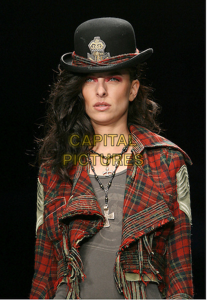 MODEL.Mercedes-Benz Fall 2006 L.A. Fashion Week - Taverniti So Jeans Fall 2006 held at Smashbox Studios, Culver City, California, USA..March 21st, 2006.Photo: Zach Lipp/AdMedia/Capital Pictures.Ref: ZL/ADM.catwalk runway headshot portrait plaid hat black red cross crucifix necklace.www.capitalpictures.com.sales@capitalpictures.com.© Capital Pictures.