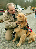Sago, WVa - January 5, 2006 -- Frank T. Shane, Executive Director, K-9 Disaster Relief Foundation, and his dog, Buddy, outside the Sago Baptist Church in Sago, West Virginia on January 5, 2006.  They were in the church on Monday evening, January 2, 2006, when the first news about 12 survivors in the Sago 1 mine and the later truth about the miner's fate was announced to the families.  Mr. Shane and Buddy's father, Nike, were at Ground Zero in New York on September 11, 2001 providing grief counseling to the victims.   .Credit: Ron Sachs / CNP