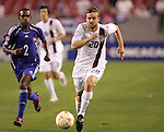 11 March 2008: Eddie Gaven (USA) (20) dribbles past Erlys Garcia Baro (CUB) (2). The United States U-23 Men's National Team tied the Cuba U-23 Men's National Team 1-1 at Raymond James Stadium in Tampa, FL in a Group A game during the 2008 CONCACAF's Men's Olympic Qualifying Tournament.