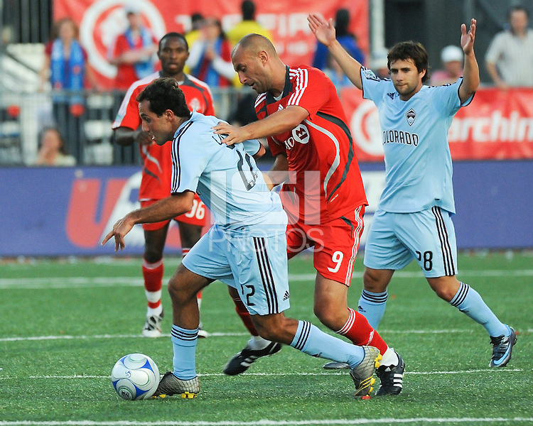 Nick LaBrocca (22) of Colorado tries to maintain control of the ball against Danny Dichio (9) of Toronto. BMO field in Toronto on June 14, 2008. Toronto defeated Colorado 3-1.