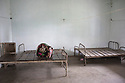 India – West Bengal: The abandoned hospital at Bundapani Tea Estate, in the Dooars region. The garden, which houses more than 7,000 people, used to employ around 1,215 workers until it closed down in July 2013. Although health services are supposed to be provided by the companies, out of 276 tea gardens only 166 have hospitals and only 56 have resident doctors.
