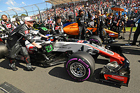 March 25, 2018: Mechanics wheel the car of Romain Grosjean (FRA) #8 from the Haas F1 Team on the grid prior to the start of the 2018 Australian Formula One Grand Prix at Albert Park, Melbourne, Australia. Photo Sydney Low