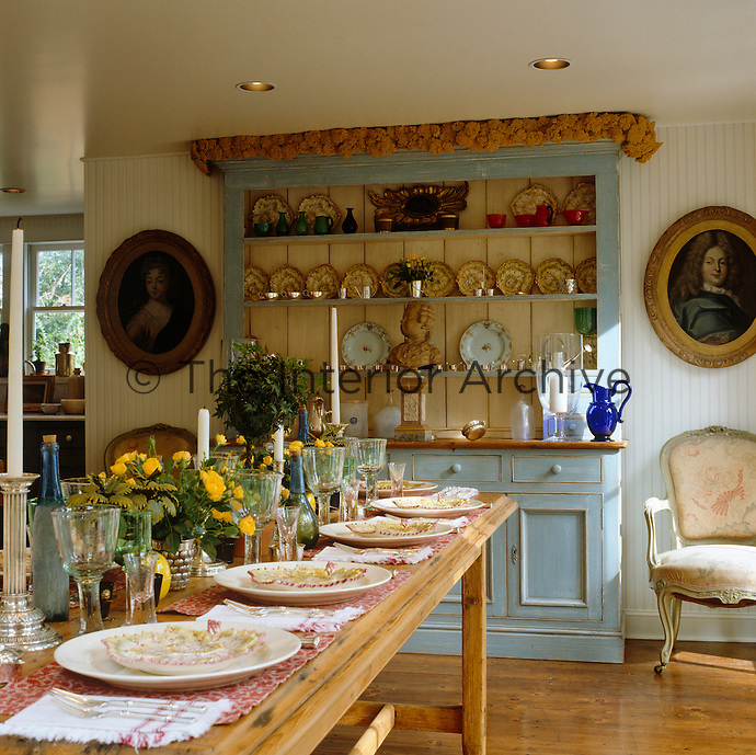 The long refectory table in the kitchen is laid for lunch